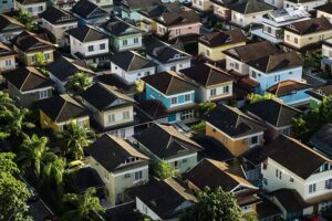 Houses in a neighborhood (Photo by Breno Assis on Unsplash)