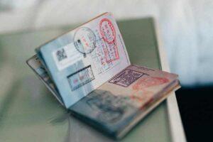 Stamped passport (Photo by ConvertKit on Unsplash)